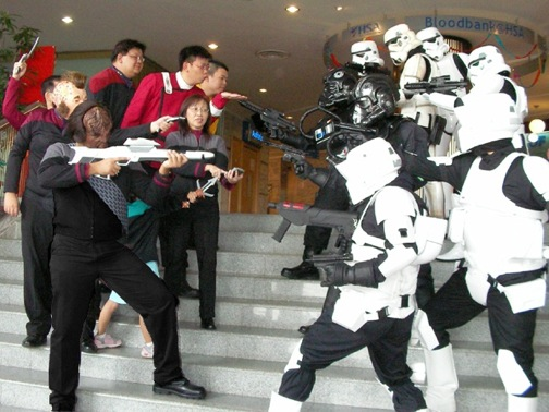 Is one of the Star Trek guys actually blowing a kiss to the Stormtroopers?
