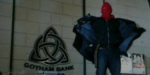 The red hood ties the outfit all together.
