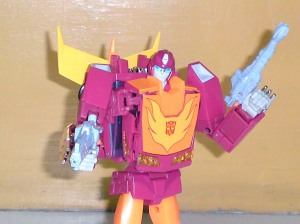 Honestly, why would Hot Rod need guns when he's got lasers built into his forearms?